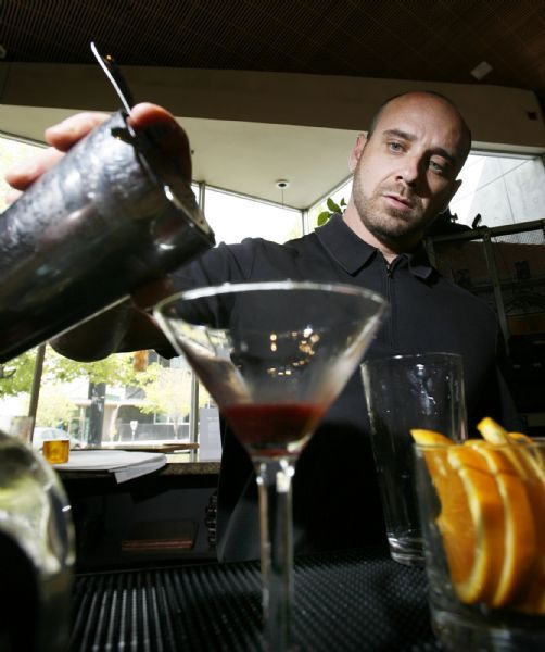 Steve Griffin  |  The Salt Lake Tribune  Salt Lake City -   Metropolitan Restaurant bartender Greg Haack mixes up a Metropolitan blood orange margarita made with Vida Tequilla  in Salt Lake City . Draper residents, John and Lisa Barlow are the owners of a tequila distillery in Mexico.  Their premium brand, Vida Tequila, has been in the Utah liquor stores for about a year and has become a popular in many Utah restaurants and bars. Thursday Apr 29, 2010.