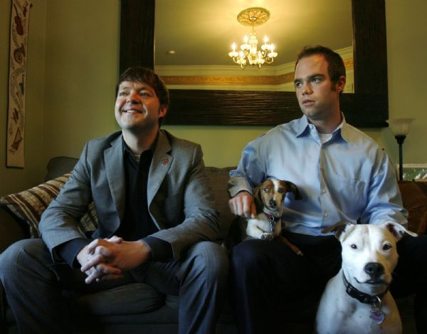 Steve Griffin  |  The Salt Lake Tribune  Salt Lake City -  Arlyn Bradshaw, left, with his partner Neil Webster and their dogs in their capitol hill home Thursday May 20, 2010. Bradshaw is one of two people running for the Salt Lake County Council's District 1.