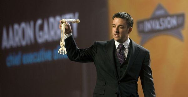 Aaron Garrity, CEO of XanGo holds up a lower leg model to tease the previous speaker