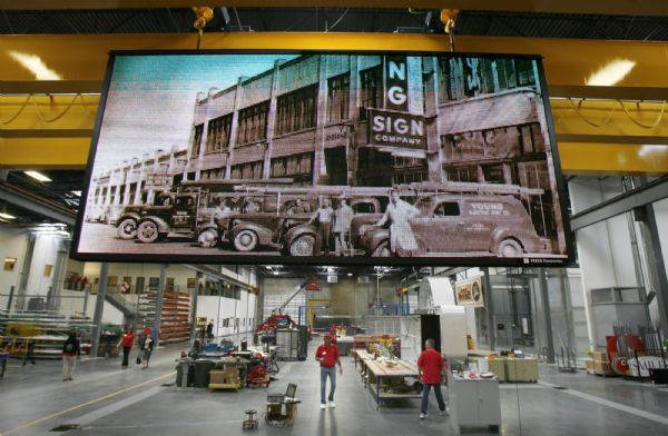 Steve Griffin  |  The Salt Lake Tribune  Salt Lake City -  A giant electronic screen displays historic photographs of Yesco's past during open house for the company;s 90th anniversary at their headquarters in Salt Lake City  Wednesday Apr 28, 2010.