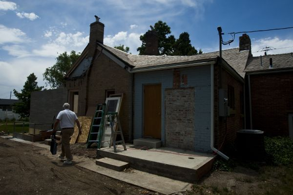 Chris Detrick | The Salt Lake TribuneThe Whitaker home is undergoing demolition and restoration Tuesday, June 29, 2010.  The Whitaker home was built between 1861-1864.