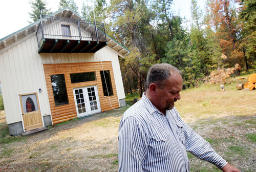 Bruce Thomson is seen in front of his home in Donnelly, Idaho Thursday, Aug. 26, 2010. Thomson spent the morning thinning brush to keep potential fire fuels away from his house.  Evacuations were ordered for homes in the Hurd fire's path, including Thomson's. (AP Photo/The Idaho Statesman, Joe Jaszewski) MANDATORY CREDIT