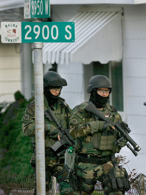 Scott Sommerdorf  l  The Salt Lake Tribune  SWAT team members walk toward the home where person of interest Steven Lee Sanchez was thought to be in Magna on Friday.
