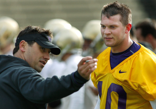 FILE - In this March 30, 2010 file photo, Washington quarterback Jake Locker, right, listens to instructions from head coach Steve Sarkisian, left, as they take part in NCAA college football practice drills on the first day of spring practice in Seattle. In his first season with Sarkisian's tutoring, Locker threw for 2,800 yards and 21 touchdowns versus just 11 interceptions. (AP Photo/Ted S. Warren, File)