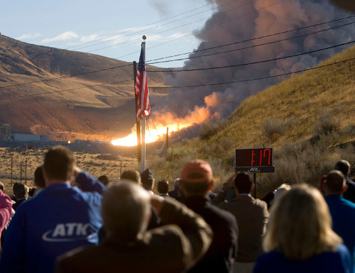 Al Hartmann  |  Salt Lake Tribune Employees of ATK, guests of NASA and contractors watch the  test fire of the first stage of the Ares 1 rocket at ATK west of Brigham City on Tuesday.
