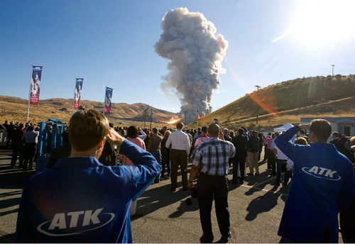 Al Hartmann  |  Salt Lake TribuneEmployees of ATK, guests of NASA and contractors watch the static test fire of the first stage of an Ares 1 rocket at ATK west of Brigham City on Tuesday.