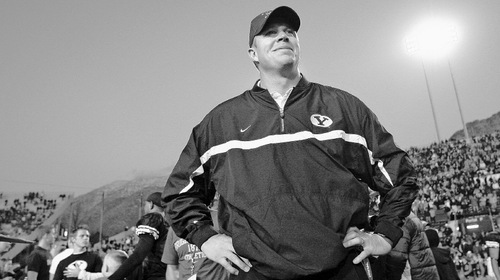 Provo,UT--11/18/06-5:14:38 PM--BYU coach Bronco Mendenhall smiles on the field after winning the game.***BYU v University of New Mexico.2nd halfChris Detrick/Salt Lake TribuneFile #_2CD4510
