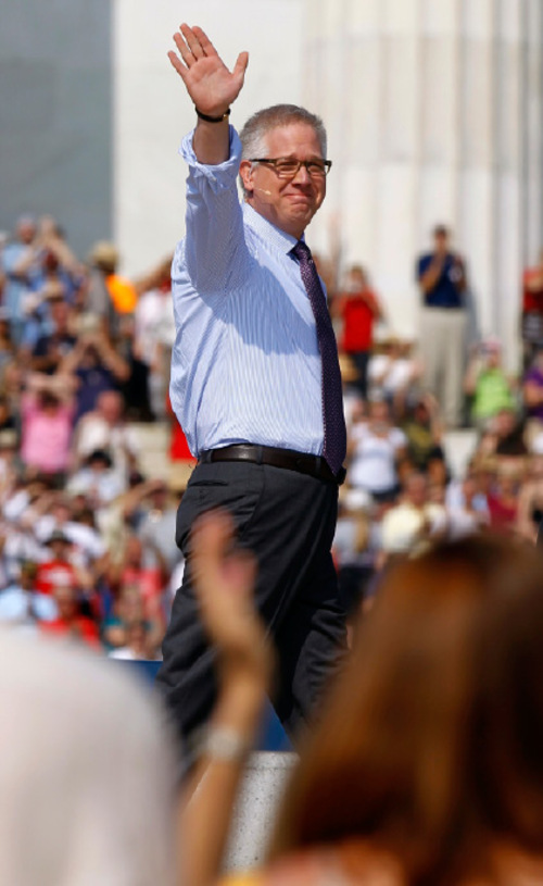 Glenn Beck waves as he arrives to speak at his