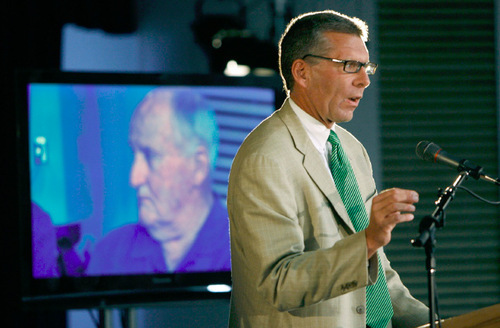 Francisco Kjolseth  |  The Salt Lake TribuneESPN's Dave Brown points to the legendary influence of former BYU coach LaVell Edwards (on screen behind) during an event announcing the Cougars' jump to football independence.