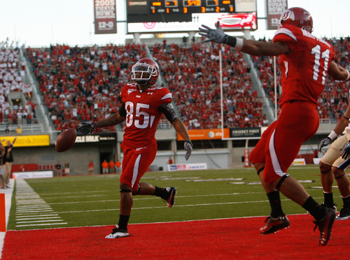 Photo by Chris Detrick  |  The Salt Lake Tribune Utah's Jereme Brooks (85) celebrates in the end zone with teammate Luke Matthews (11) during the first half of the game at Rice-Eccles Stadium Thursday September 2, 2010.