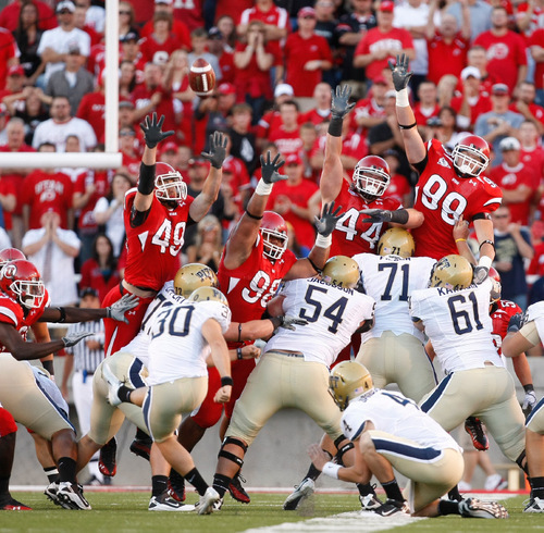 Photo by Chris Detrick  |  The Salt Lake Tribune Utah's Trevor Reilly (49), Sealver Siliga (98), Dave Kruger (44) and Joe Kruger (99) leap up to block a Pitt kick that was no good during the first half of the game at Rice-Eccles Stadium Thursday September 2, 2010.