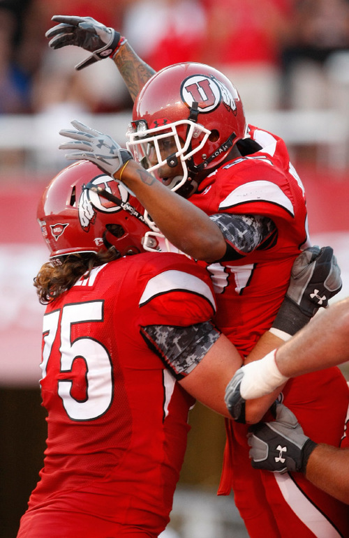 Photo by Chris Detrick  |  The Salt Lake Tribune Utah's Jereme Brooks celebrates his first half touchdown with teammate John Cullen (75, left) during the first half of the game at Rice-Eccles Stadium Thursday September 2, 2010.