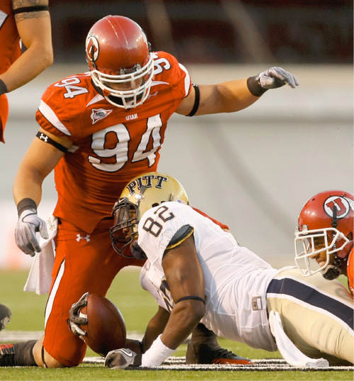 Photo by Chris Detrick  |  The Salt Lake Tribune Utah's Christian Cox (94) after bringing down Pitt's Jon Baldwin (82) during the first half of the game at Rice-Eccles Stadium Thursday September 2, 2010.