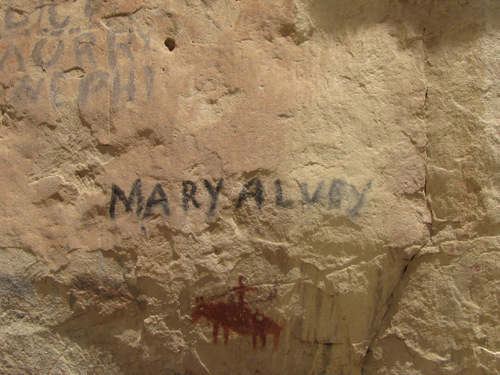 Mark Havnes | The Salt Lake Tribune Pioneer autograph of Mary Alvey and image of American Indian on a horse are examples of historic rock art at site of archaeological dig at site near Escalante that dates back at least 9,000 years.