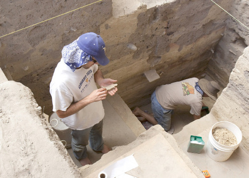 BYU grad students Brad Newbold and Mark Bodily work in the North Creek Shelter Excavation in Escalante Valley in 2006. Courtesy BYU