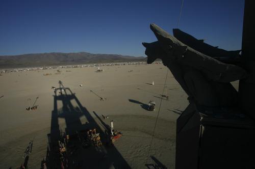 Rick Egan   |  The Salt Lake TribuneA gargoyle keeps watch over the playa  at the Burning Man Festival, Saturday, Sept. 4, 2010.  There were four gargoyles on the burning man structure; this year's theme was Metropolis.