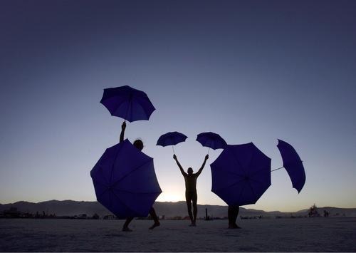 Rick Egan   |  The Salt Lake TribuneUmbrella dancers at dusk, at the Burning Man Festival, Saturday, Sept. 4, 2010.