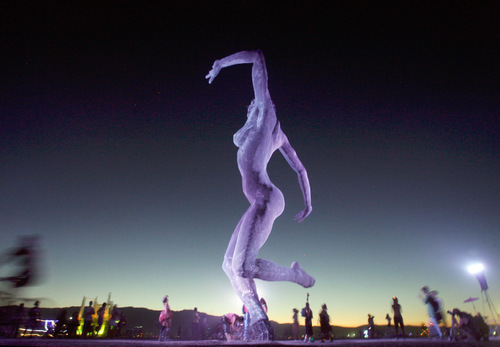 Rick Egan   |  The Salt Lake TribuneThe 40-foot  Bliss Dance sculpture by Marco Cochrane  towers above the participants during the Burning Man Festival in Nevada, Friday, Sept. 3, 2010.