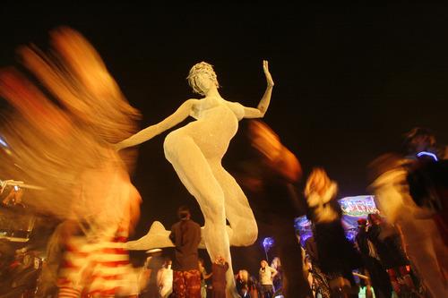 Rick Egan   |  The Salt Lake TribuneBurners dance near the Bliss Dance sculpture by Marco Cochrane during the Burning Man Festival in Nevada, Friday, Sept. 3, 2010.