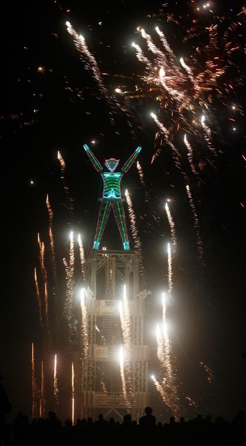 Rick Egan   |  The Salt Lake TribuneFireworks explode before the man goes up in flames during the Burning Man Festival,   Friday, Sept. 3, 2010.