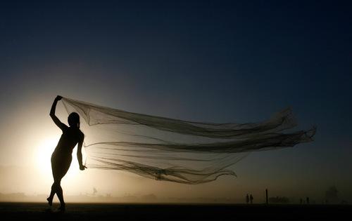 Rick Egan   |  The Salt Lake TribuneShannon Sahaja, from Lake County, Calif., dances at dusk, during the Burning Man Festival, Saturday, Sept. 4, 2010.