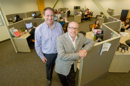 Chief Operating Officer Martin Senn and President and CEO of Davinci Virtual Office Solutions, Bill Grodnik stand in one of the company's call answering centers in Sugar House.  The location answers phones for companies throughout the United States. Paul Fraughton/ The Salt Lake Tribune file photo