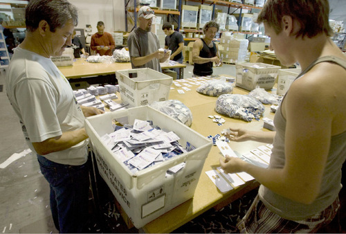 Steve Griffin  |  The Salt Lake Tribune Molding Box employees work together to fill a blister pack order at the company's offices in Draper in September. The company prints documents on a big scale, copies CDs and DVDs in a mass production way and handles shipping for a variety of companies, is in the top 100 of Inc. magazine's fastest-growing companies for 2010.