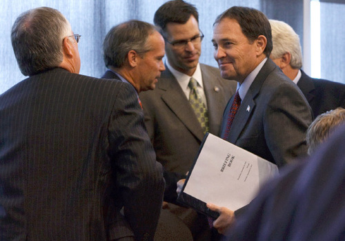 Leah Hogsten  |  The Salt Lake TribuneGov. Gary Herbert, right, exchanges greetings with ATK President and CEO Mark DeYoung and Clearfield Mayor Don Wood (back to camera) after the aerospace company announced plans Thursday to open a manufacturing facility in the city that will hire 802 workers and contribute more than $1 billion to Utah's economy over the next two decades.
