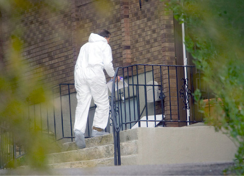 Al Hartmann  |  Salt Lake TribuneCrime scene investigator enters home at 2184 N. Snowqualme Dr. in Layton Thursday afternoon September  9th.    Two children, ages 7 and 8 were found dead there Wednesday evening.