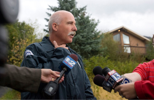 Al Hartmann  |  Salt Lake TribuneLayton Police Lt. Quinn Moyes gives statement to press outside home at 2184 N. Snowqualme in Layton where two children, 7 and 8 were found dead.   He gestures that marks were found around the necks of the children that were consistent with strangulation, however he said that cause of death was still to be determined by medical examiner.