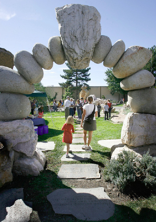 Scott Sommerdorf  l  The Salt Lake Tribune Visitors to the Gilgal Sculpture Garden pass through a stone gate made by artist Thomas B. Child. In 2010, the garden celebrated its 10th anniversary as a Salt Lake City public park.