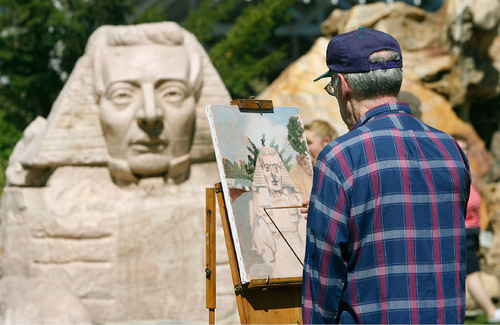 Scott Sommerdorf  l  The Salt Lake Tribune  Artist Frank Fuller paints the Sphinx with the head of Joseph Smith at Gilgal Garden in Salt Lake City on Sunday.
