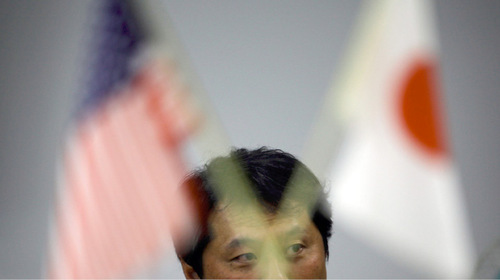 A money trader sits at a trading station in Tokyo Wednesday, Sept. 15, 2010. Japan intervened in the currency market Wednesday for the first time in six years to weaken the yen, which had spiked to 15-year highs against the dollar, battering the country's vital exporters. (AP Photo/Junji Kurokawa)