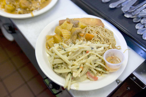 Paul Fraughton  |  The Salt Lake TribuneA lunch special of green curry with wide rice noodles, beef massaman and a fried spring roll at My Thai in Salt Lake City.