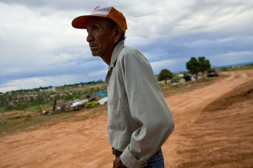 Chris Detrick  |  The Salt Lake Tribune Harry Hutchins, 74, walks around the Westwater Navajo community Wednesday August 18, 2010. The roughly two-dozen Navajo residents of Westwater, many who are elderly, live without running water, plumbing, sewage disposal or electricity.