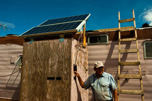 Chris Detrick  |  The Salt Lake Tribune Albert Cly, 71, shows off the solar electricity panels he installed in his home in the Westwater Navajo community Thursday August 19, 2010. The roughly two-dozen Navajo residents of Westwater, many who are elderly, live without running water, plumbing, sewage disposal or electricity.