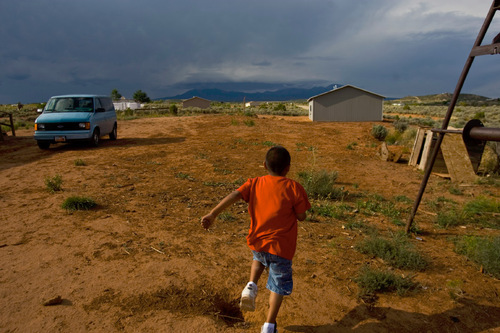 Chris Detrick  |  The Salt Lake Tribune Danny Gonzalez, 6, plays outside of his home in Westwater Thursday August 19, 2010. The roughly two-dozen Navajo residents of Westwater, many who are elderly, live without running water, plumbing, sewage disposal or electricity.