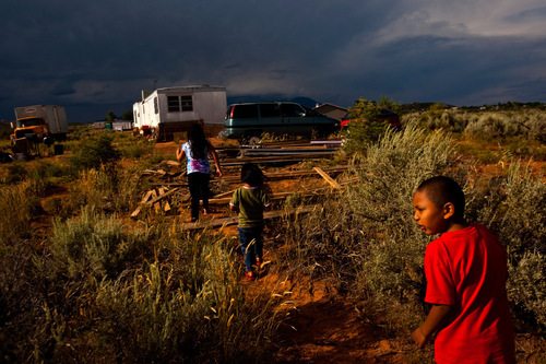 Chris Detrick  |  The Salt Lake Tribune Danny Gonzalez, 6, right, Sophia Gonzalez, 3, center, and Faith Billsie, 9, play in August outside of their home in Westwater. The children live with their grandmother in the small community adjacent to Blanding. Like the other Navajo residents, the family lives in a trailer without modern conveniences, sometimes sleeping in front of the wood stove and covering the door with a blanket to keep out the cold. In winter, they store milk outside in an old car. In the summer, they use a cooler. They shower at a relative's house in town.