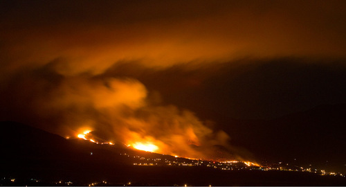 Jim Urquhart | The Salt Lake Tribune Smoke drifts south then back to the north as the Machine Gun wildfire burns in Herriman, Utah, Monday,September 20, 2010. Approximately 1,400 homes were evacuated ahead of the fire's path.
