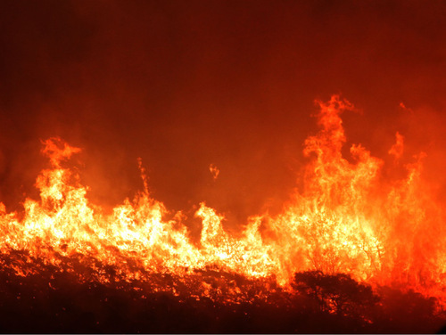 Rick Egan   |  The Salt Lake TribuneA wildfire burns in the hills above Herriman, at about 3 a.m.,  Monday, Sept. 20, 2010. About 1,400 homes had been evacuated at the time.