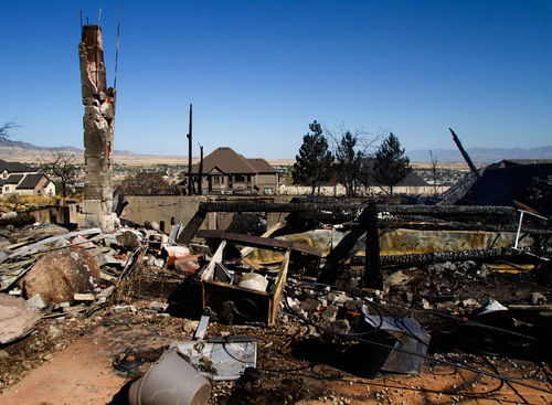 Jim Urquhart | The Salt Lake Tribune   A home destroyed by the Machine Gun wildfire on Log Home Lane in the foothills of Herriman, Utah, Monday,September 20, 2010. Approximately 1,400 homes were evacuated ahead of the fire's path.