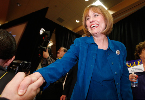 FILE - In this Tuesday, June 8, 2010 picture, Sharron Angle shakes hands of supporters after winning the Nevada Republican U.S. Senate primary election race in Las Vegas. The Nevada Republican Senate candidate's conservative views on illegal immigration and her limited outreach to Hispanics have done little to endear her to Nevada's largest minority group. The tea party favorite is challenging Senate Majority Leader Harry Reid in a swing state that borders Arizona, where a recent effort to enact a strict immigration law has polarized voters nationwide. (AP Photo/Isaac Brekken)
