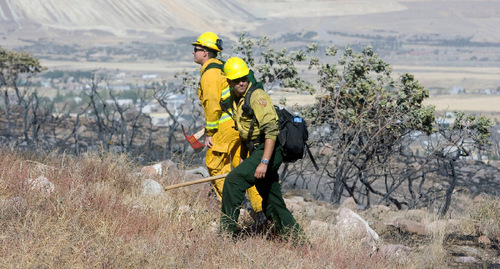Al Hartmann  |  The Salt Lake Tribune Unified Fire Dept. firemen Tyler Owensbey, left,  and Anthony Widdison, walk the edge of a burned area looking for hot spots above the burned hills above Herriman on Tuesday September 21st.