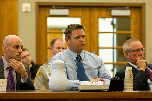 Michael Pratt, center, and his two lawyers, Jeremy Delicino, left, and Stephen McCaughey, wait for the judge's final decision for Pratt's sentence Monday, Sept. 20, 2010, at the Fourth District Court in American Fork.Pratt was sentenced to 5 years to life in prison.ANDREW VAN WAGENEN/ Daily Herald