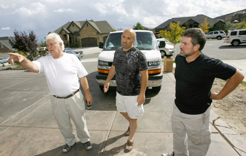 Francisco Kjolseth  |  The Salt Lake Tribune Sylvan Olsen, left, talks Wednesday about the Herriman fire alongside his neighbor, Jim Conforti, and his son, Jon Olsen. The neighbors, who come from all walks of life, came together to dampen the areas surrounding their homes.