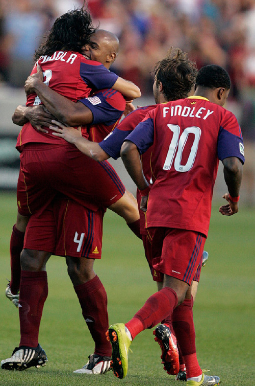 Djamila Grossman     The Salt Lake TribuneRSL's Fabian Espindola (7) and Jamison Olave (4) celebrate shortly after a goal in the first half against the New York Red Bulls at Rio Tinto Stadium in Sandy, Saturday, September 4, 2010.