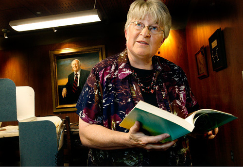 Scott Sommerdorf  l  The Salt Lake Tribune Leonard J. Arrington's daughter, Susan Madsen, reads form one of her father's books in the Merrill Library at Utah State University in Logan, August 30, 2010.