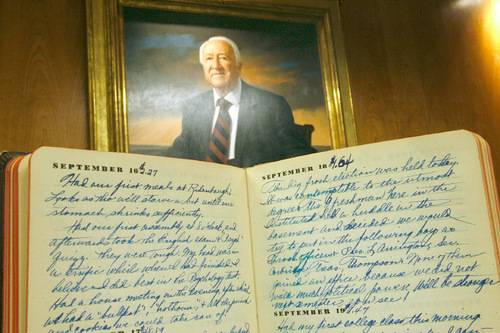 Scott Sommerdorf  l  The Salt Lake Tribune The portrait of Leonard J. Arrington hangs in the Merrill Library where the writings of Arrignton are kept. An early 1935 diary of Arrignton's is in the foreground. The diary of Leonard Arrington, famed Utah historian and former LDS Church Historian who died in 1999, is finally available to the public in the Special Collection at USU Library.