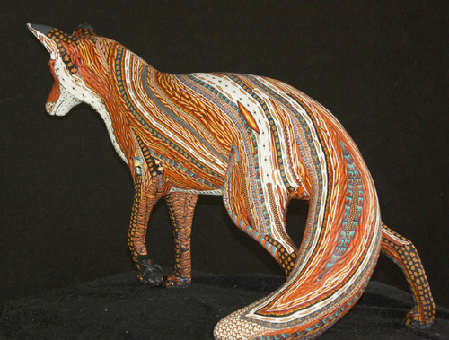 Adam Rees makes animal sculptures covered in a multi-colored mosaic of small, clay