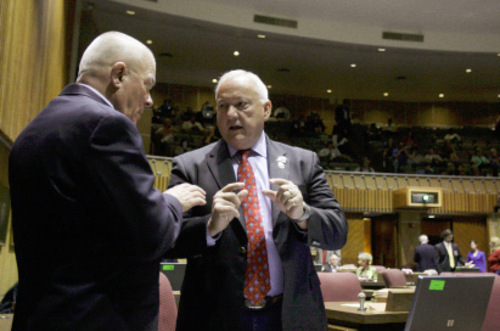Ross D. Franklin     The Associated PressArizona state Sen. Russell Pearce, R-Mesa, right, speaks with Sen. Al Melvin, R-Tucson, before an April vote on an immigration bill, in Phoenix.  Arizona lawmakers approved a sweeping immigration bill Monday intended to ramp up law enforcement efforts even as critics complained it could lead to racial profiling and other abuse.